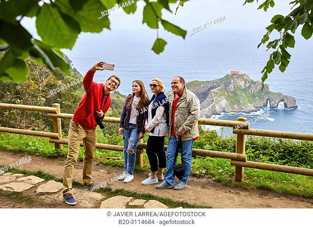 Tour guide with group, Tour along the coast of the Basque Country, San Juan de Gaztelugatxe, Bizkaia, Basque Country, Spain, Europe