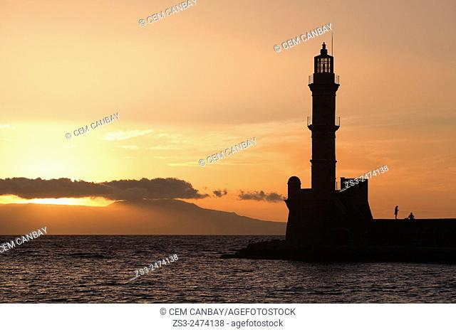 Silhouettes of people near the lighthouse at sunset, Chania, Crete, Greek Islands, Greece, Europe