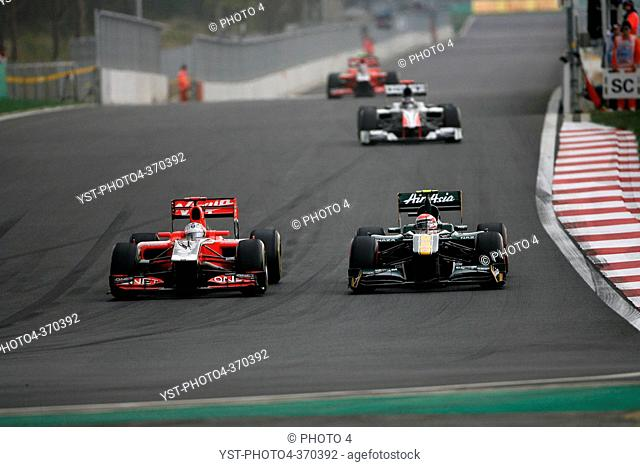 Race, Timo Glock GER, Marussia Virgin Racing VR-02 and Jarno Trulli ITA, Team Lotus, TL11, F1, Korean Grand Prix, Yeongam, Korean