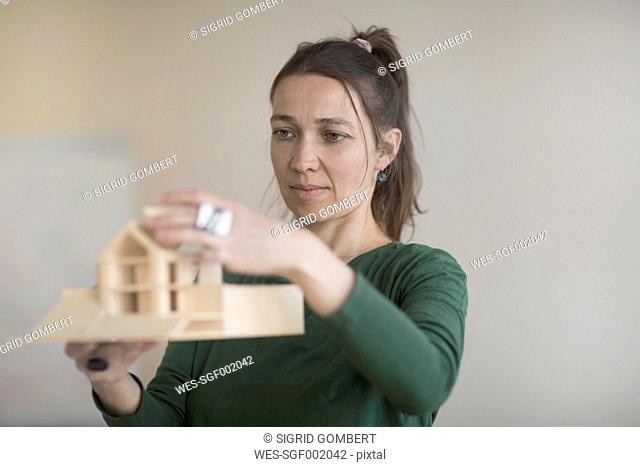 Woman looking at architectural model