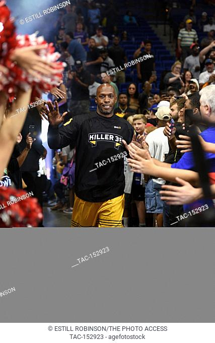 Chauncey Billups walks through the sea hands at the BIG3 game at Rupp Arena in Lexington, Kentucky August 6, 2017