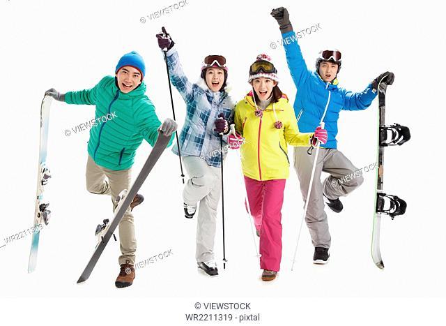 Young men and women ski