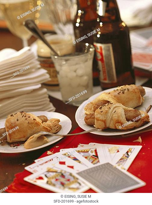 Party Table Scene with Pigs in a Blanket and Beer, Cards