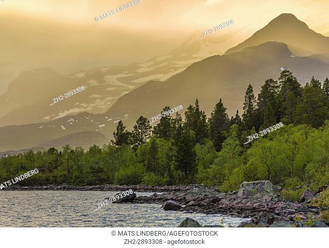 Sun shining on mountain and make it glow, snow on the mountain, Stora sjöfallets national park, Gällivare, Swedish Lapland, Sweden