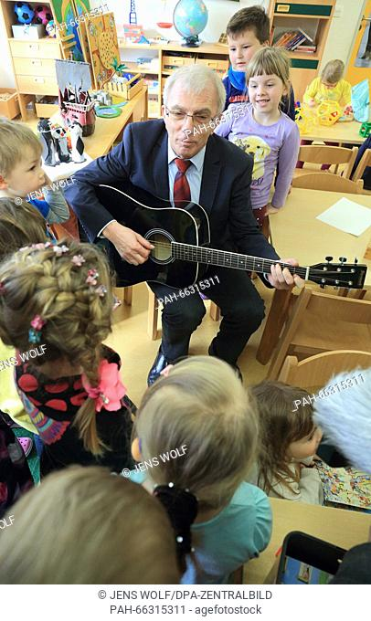 Norbert Bischoff (SPD), Minister for Labour and Social Affairs Saxony-Anhalt, plays the guitar in the child daycare center 'Kunterbunt' in Magdeburg...