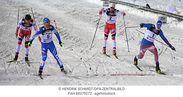 Federico Pellegrino (2-L) celebrates while crossing the finishing line at the 2017 Nordic World Ski Championships in Lahti, Finland, 23 February 2017
