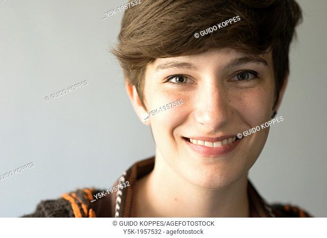 Tilburg, Netherlands. Studio-portrait of a young brunette Philosophy student at Tilburg University
