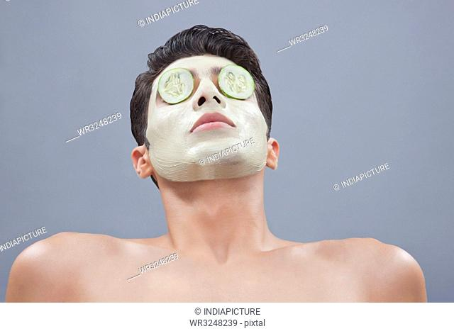 Young man getting a facial