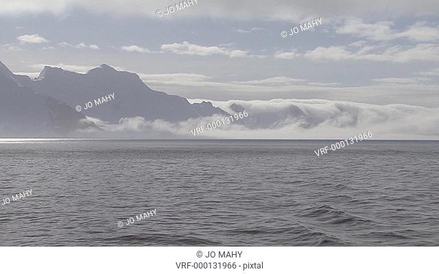mist rolls over the land, Drakes Passage, Antarctic peninsula