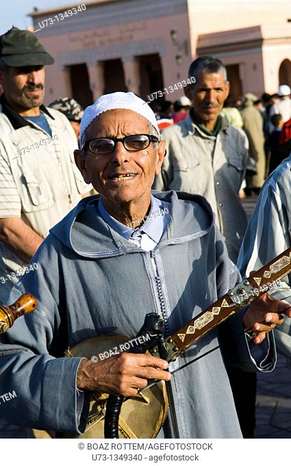 Moroccan musicians playing traditional musical instruments in the Djma el Fna sq  in Marrakesh, Morocco