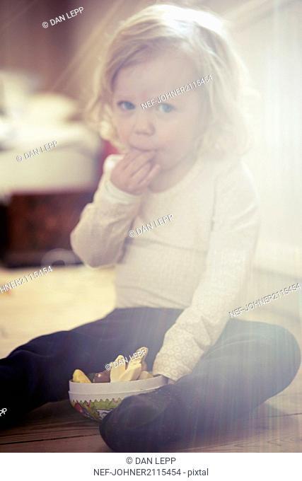 Toddler girl having a snack