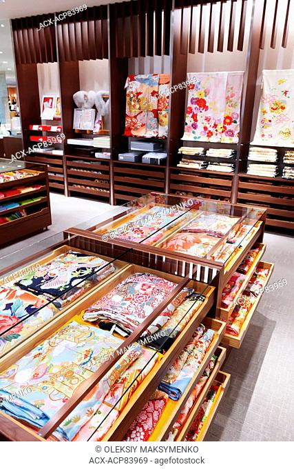 Fabrics with colorful patterns on display in a store in Tokyo, Japan