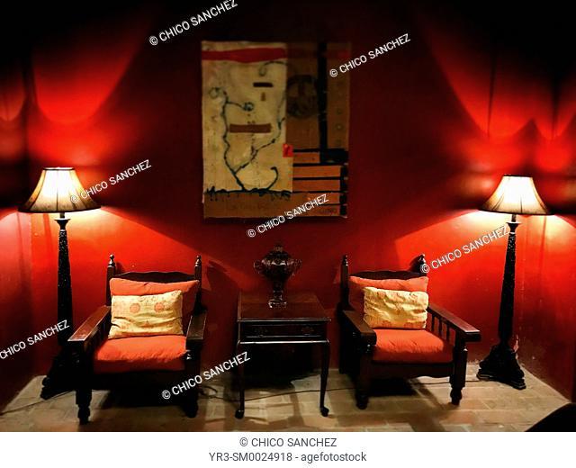 Lamps illuminate a red room in the Hotel California in Todos Santos, Baja California Sur, Mexico. An urban legend tells pop band Eagles composed their album...