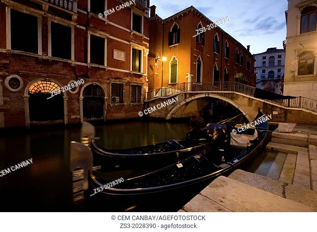 Gondols on a tranquil canal at night in Rialto District, Venice, Italy, Europe