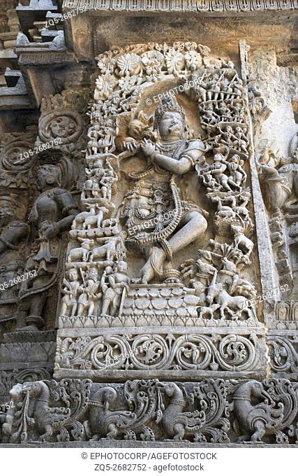 Sculpture of lord Krishna as Muralidhar (playing flute), west side wall, Hoysaleshwara temple, Halebidu, Karnataka, india