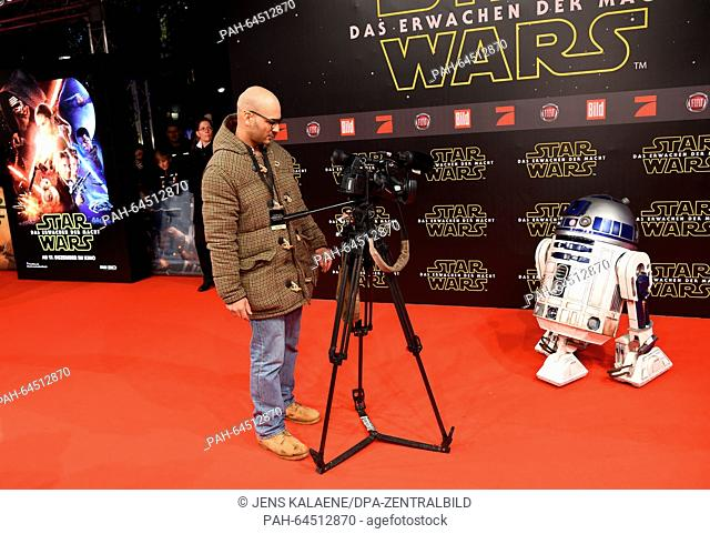 The droid R2D2 poses on the red carpet at the German premiere of the new film 'Star Wars:The Force Awakens' in the Zoo Palast cinema inBerlin,Germany
