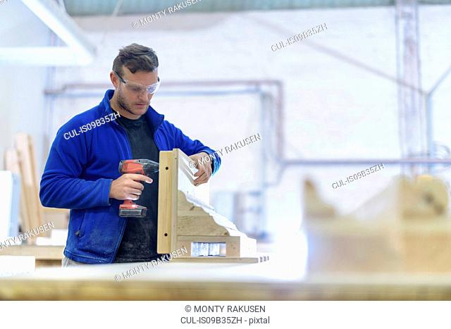 Carpenter making moulds in architectural stone factory