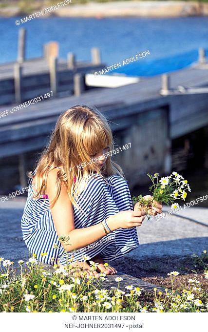 Girl picking flowers
