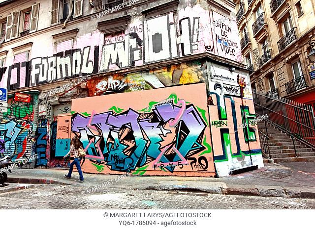 Old, historic architecture with graffiti on the walls, Montmartre in Paris France, Europe
