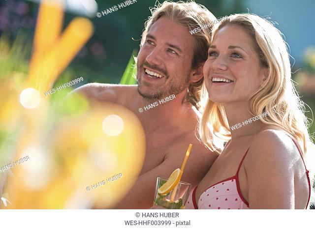 Austria, Salzburg County, Couple with drink near pool