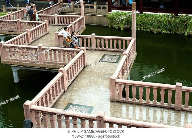 Zigzagging bridge crosses an ornamental lake at the Yu Bazaar, Shanghai, China. There is free access to this area, which is not a paid attraction