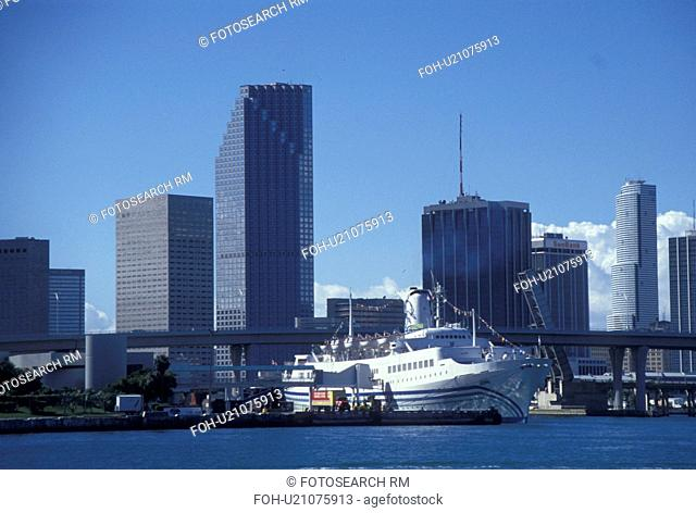 cruise ship, Miami, FL, Florida, Atlantic Ocean, Cruise ship docked at the Port of Miami Biscayne Bay with a view of the downtown skyline of Miami