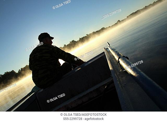 A man sitting on a boat, Primorsk, Russia