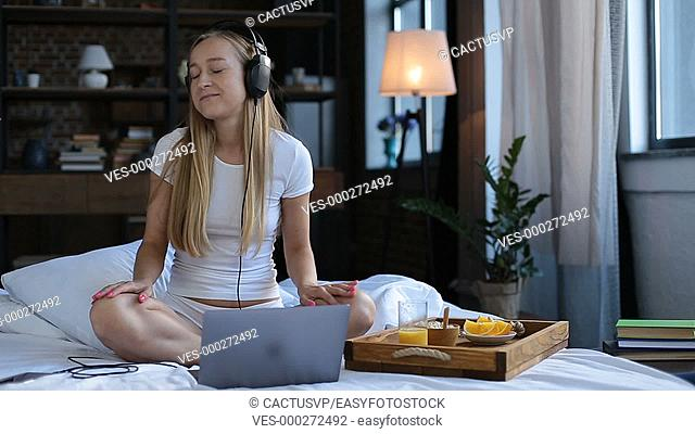 Carefree woman enjoying perfect morning in bed
