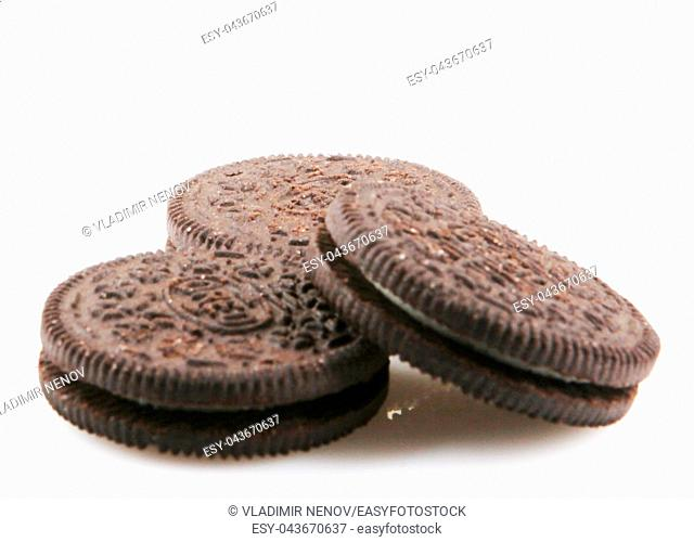 Oreo isolated on white background. Oreo is a sandwich cookie consisting of two chocolate disks with a sweet cream filling in between