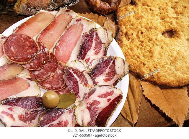 Restaurant Le Refuge, at Piedicroce: pork goodies, 'lonzo','coppa','saucisson corce', and 'zriachuli' bread. Corsica. France