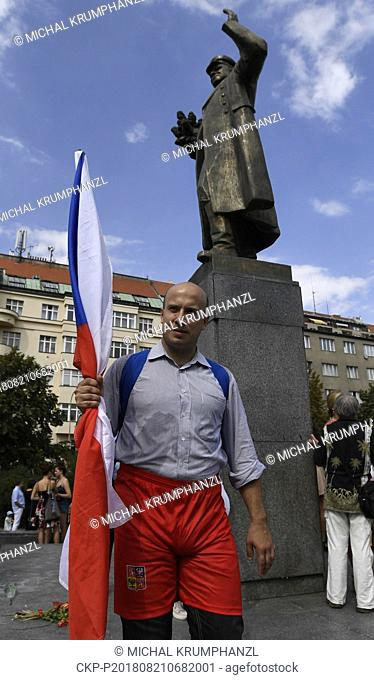 A several people protest after an unveiling of restored memorial to Soviet Marshal Konev with new plaques describing his life and work, in Prague
