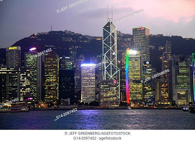 China, Hong Kong, Kowloon, Tsim Sha Tsui, Kowloon Public Pier, view, Victoria Harbour, harbor, Island, city skyline, high rise skyscrapers, buildings, dusk