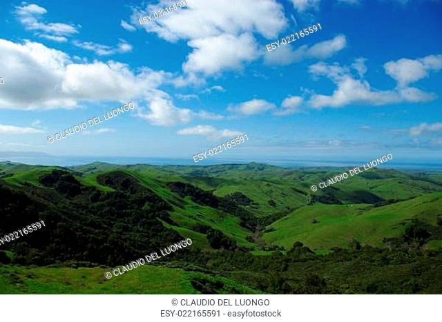 Green hills and Pacific Ocean with Morro Bay in the distance, California