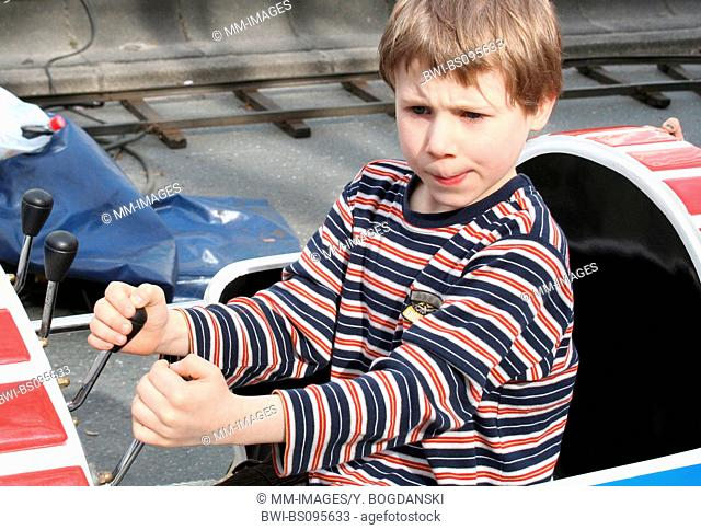 boy on the carousel, Germany