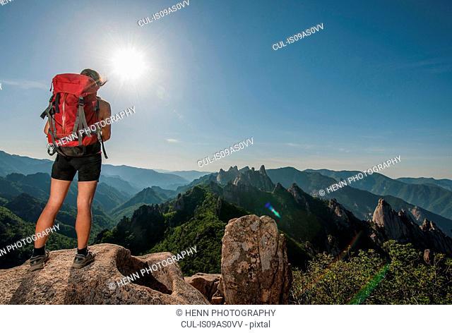 Female hiker enjoying view from ridge at Seoraksan National park, Gangwon, South Korea
