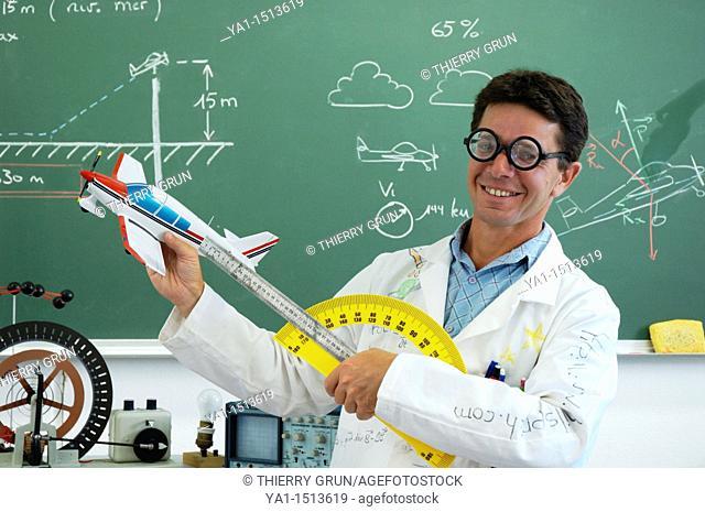 Funny school teacher explaining motorized flight with model plane