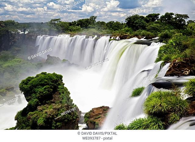 Iguassu Falls is the largest series of waterfalls on the planet, located in Brazil, Argentina, and Paraguay  At some times during the year one can see as many...