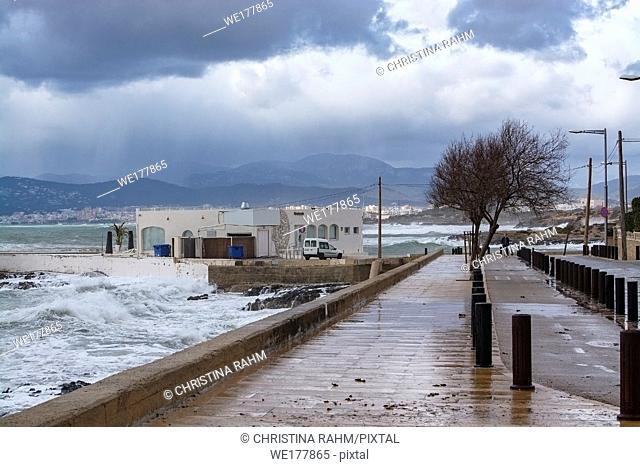 Sea water breaks against rocks and inundates promenade on a stormy winter day in Mallorca, Spain