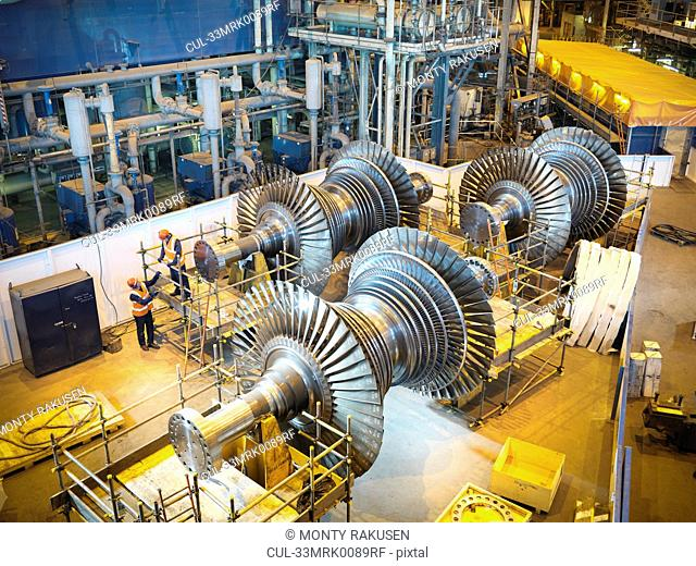 Workers with turbines in power station