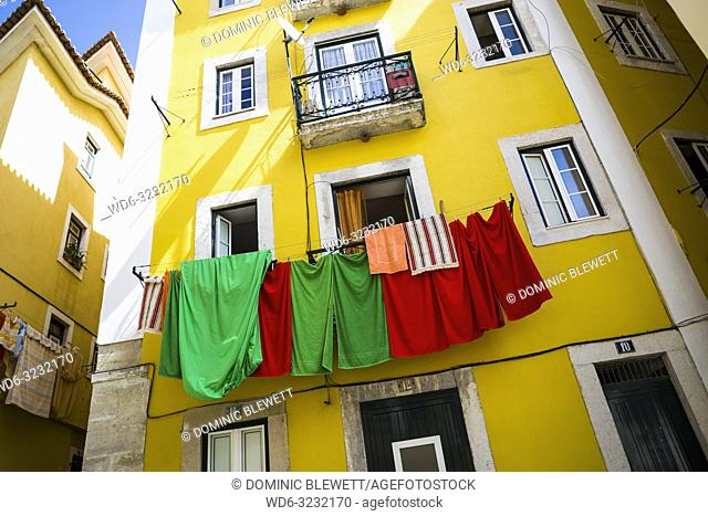 Laundry hangs from a balcony in Lisbon, Portugal