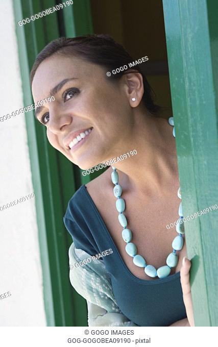 Woman smiling in doorway
