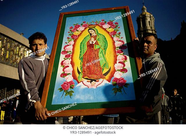 Pilgrims carry an image of the Our Lady of Guadalupe in Mexico City, December 10, 2010  Hundreds of thousands of Mexican pilgrims converged on the Our Lady of...
