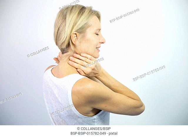A woman feeling pain in her neck