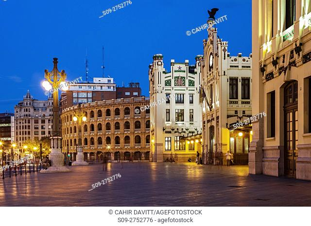 The front facade of the Estacio del Nord railway Station and Plaza de Toros de Valencia in Valencia at twilight, Xativa - Marques de Sotelo, Valencia