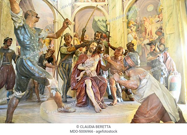 The soldiers mocking about Jesus by putting the crowd of thorns on his head in the Eighth Chapel dedicated to the Crown of thorns and located in the Sacro Monte...