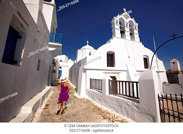 Woman near an Orthodox church in the old town Chora, Amorgos, Cyclades Islands, Greek Islands, Greece, Europe