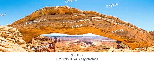 Mesa Arch is situated on the edge of a plateau at the Island in the Sky District of Utah's Canyonlands National Park
