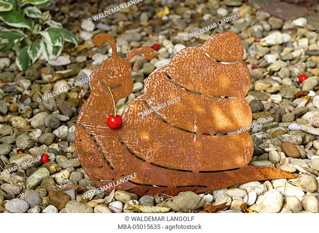 Snail made of metal for garden decoration, cherry