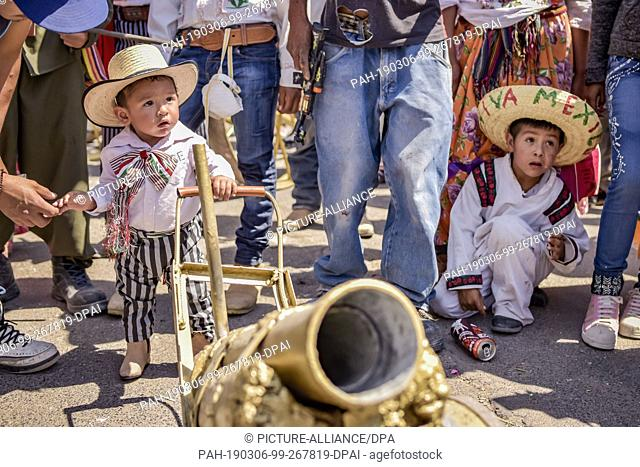 "05 March 2019, Mexico, San Juan de la Vega: Children in typical costumes take part in the """"Festival of Explosive Hammers"""""