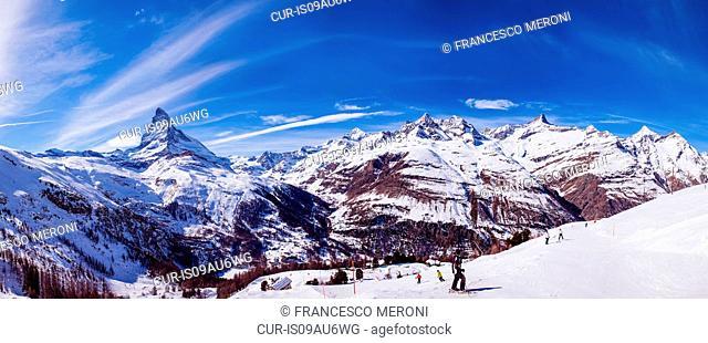 Panoramic view of ski slopes and skiers, Zermatt, Switzerland